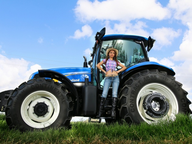 Wallpaper Girl in hat and big tractor